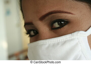 sars - a filipina wears a surgical mask to prevent sars
