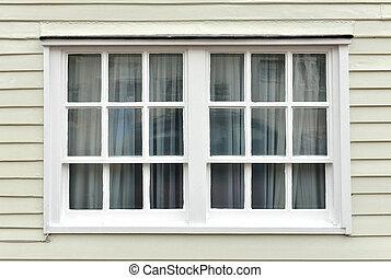 Old sash window and weatherboarding on house