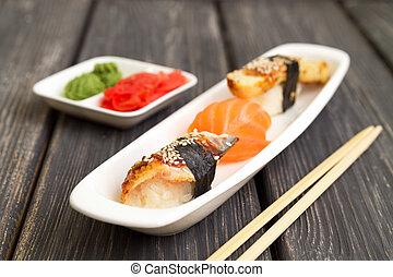 sashimi cuisine on a white plate of vassabi ginger