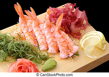 sashimi ebi on a board - sashimi eb with shrimps, lemon ...