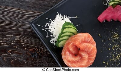 Sashimi, ginger and wasabi. Japanese dish top view.