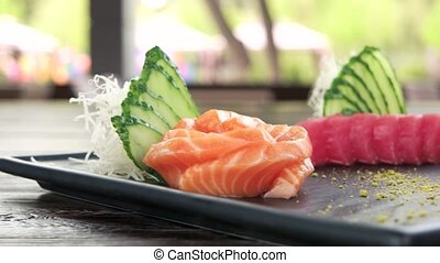 Sashimi plate close up. Kataifi dough, fish and wasabi.