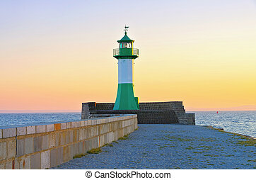Sassnitz on island Ruegen, lighthouse in the evening