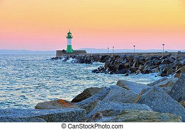 Sassnitz on island Ruegen, lighthouse in the evening