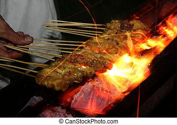 Satay on grill