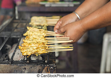 Satay on grilled stove.
