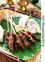 Beef satay, roasted meat skewer Asia food. Traditional Southeast Asia food. Hot and spicy Southeast Asian dish, Asian cuisine.
