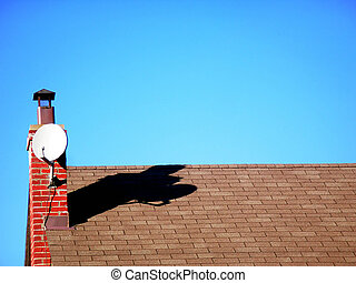 Satelite Dish - Satelite dish casing a shadow onto a roof...