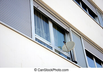 Satellite dish at the window