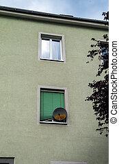 satellite dish on house facade