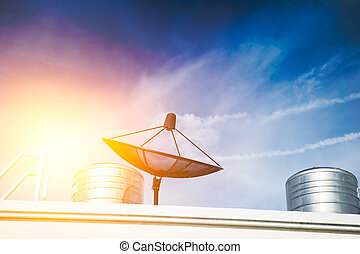 Satellite dish on roof top, TV communication technology connect people from around the world.