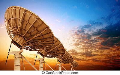Satellite dish - Satellite antenna dusk background