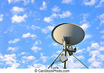 Satellite dish - a satellite dish with a blue sky with many...