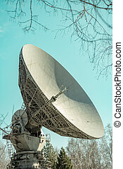 Satellite dish transmission data on blue background