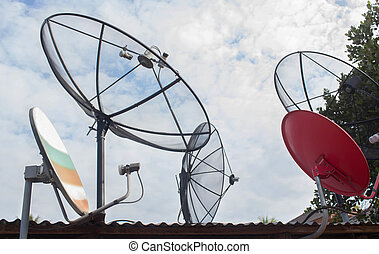 Satellite dish with sky on roof - Satellite dishes on a...