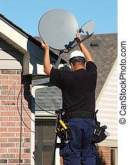 Satellite dish worker installing service