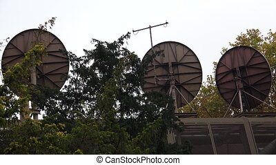 Satellite dishes on the roof. 4K.