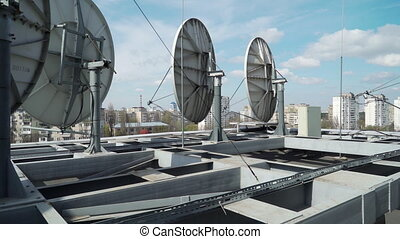 satellite dishes on the roof of the building