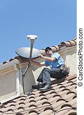 Satellite Installer on Roof 2 - Installation of satellite...