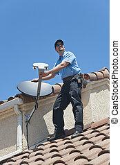 Satellite Installer on Roof - Installation of satellite dish...