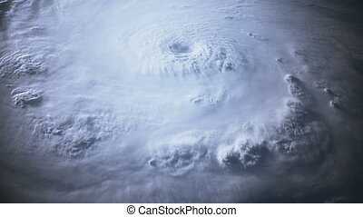 Satellite view of a large hurricane with a well defined eye....