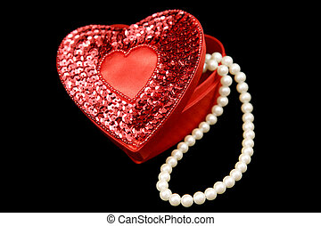 Satin Heart & Pearls - A red satin heart shaped box filled...