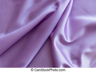 Satin lilac fabric top view. Beautiful pleats on the fabric.