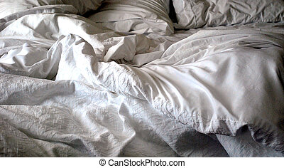 satin sheets on a luxury bed