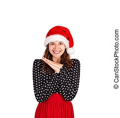 satisfied and dreamy female laughing joyfully holding palms near heart and gazing up from happiness and joy. emotional girl in santa claus christmas hat isolated on white background. holiday concept