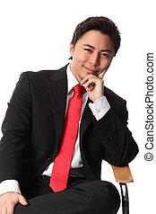 Satisfied businessman sitting