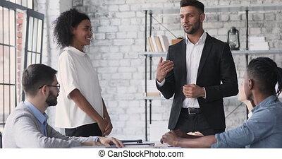 Satisfied caucasian male boss handshake promote happy african female employee