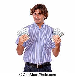 Satisfied charming man smiling holding dollars