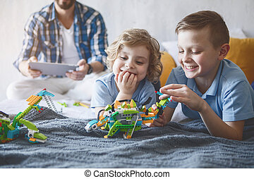 Satisfied children having fun with toys