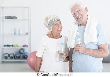 Satisfied couple of elderly people