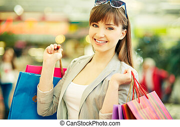 Satisfied customer - Pretty lady with colorful shopping bags...