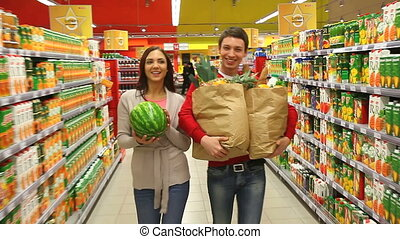 Satisfied customers - Happy customers carrying purchases,...