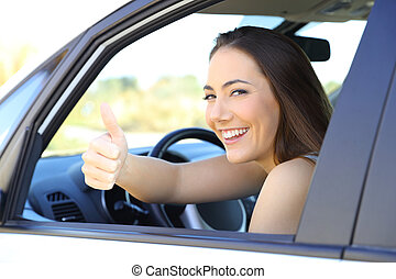 Satisfied driver with thumbs up in a car
