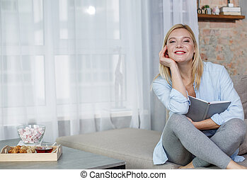 Satisfied female taking rest in living room