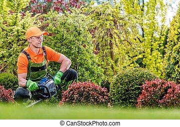Satisfied Gardener in a Garden