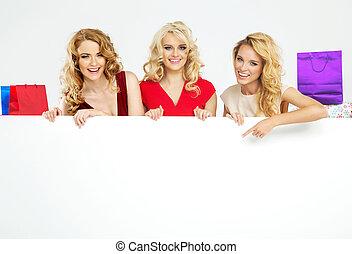 Satisfied girls holding the billboard