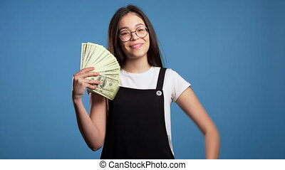 Satisfied happy excited asian girl showing money - U.S. ...