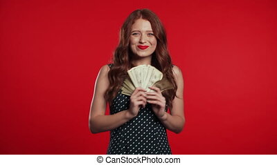 Satisfied happy excited girl showing money - U.S. currency ...