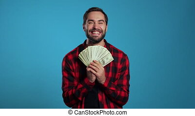 Satisfied happy excited man showing money - U.S. currency ...