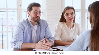 Satisfied hr recruit team managers handshake hire female candidate at job interview, smiling employer shake hand of young intern seeker offering work professional contract, staff employment concept