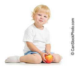 Satisfied kid eating apple