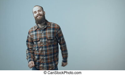 Satisfied man dancing joyfully - Satisfied bearded man...