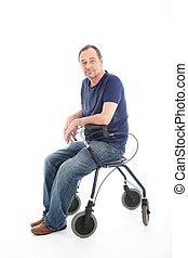 Satisfied man resting on a health walker - Satisfied...