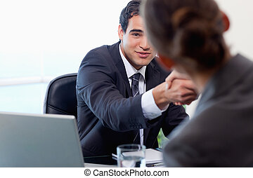 Satisfied manager interviewing a female applicant