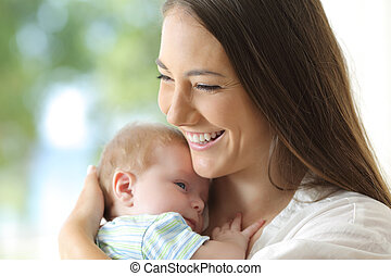 Satisfied mother holding her baby
