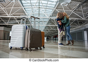 Satisfied relatives meeting at the airport - Low angle of ...